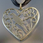Dove and heart pendant